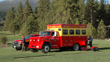 Search and Rescue vehicles within Missoula County forested area.