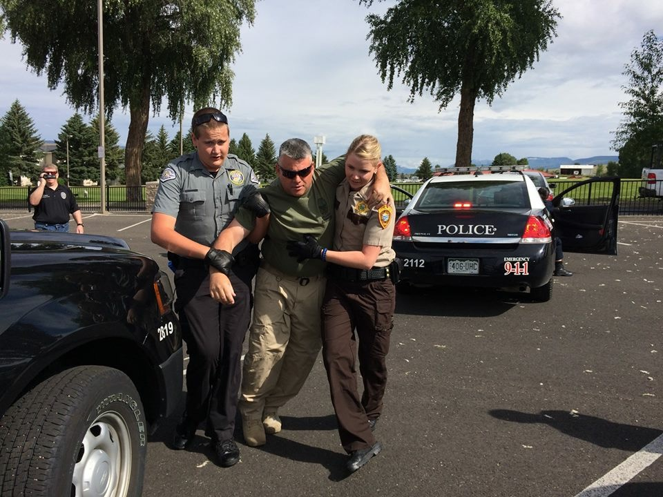 MCSO cadet helping victim.